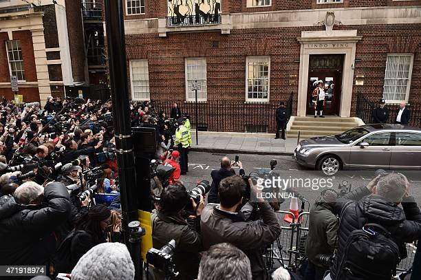 Town crier Tony Appleton makes an announment of the birth of Catherine Duchess of Cambridge and Prince William's second child a daughter from the...