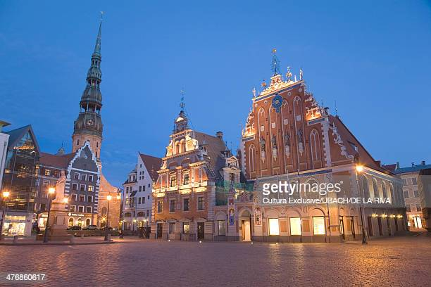 Town hall square and St Peters Church at night, Riga, Latvia