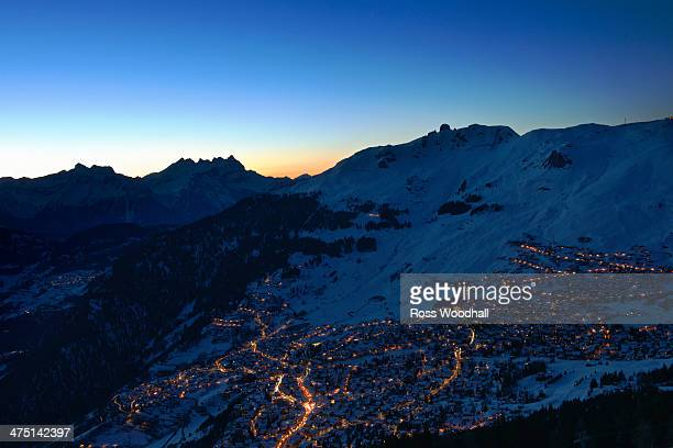 Town in mountains at night, Verbier, Switzerland