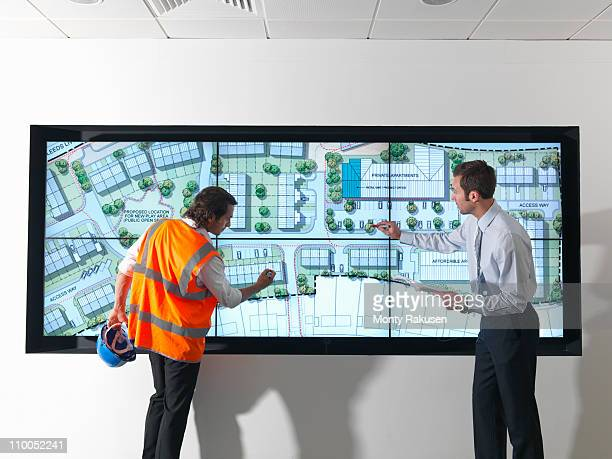 Town planners look at plans on screen