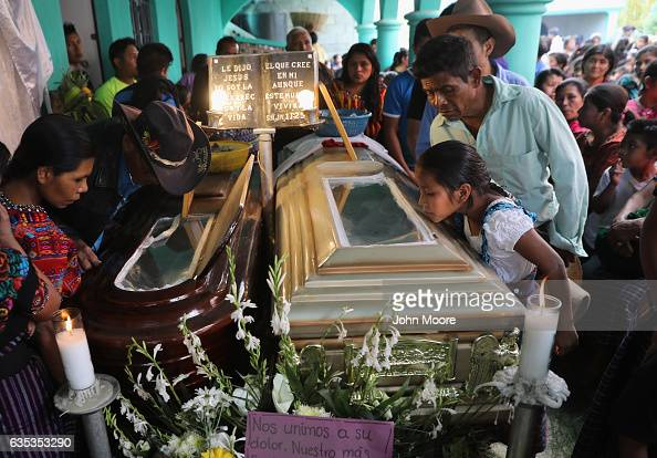 Town residents attend a wake for two boys who were kidnapped and killed on February 14 2017 in San Juan Sacatepequez Guatemala More than 2000 people...