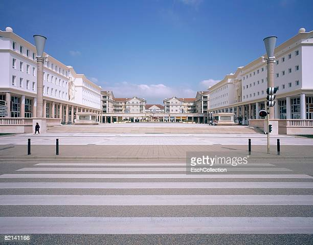 Town square with newly built shopping gallery in neo-classical style.