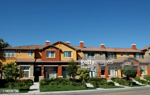 townhouses against clear blue sky