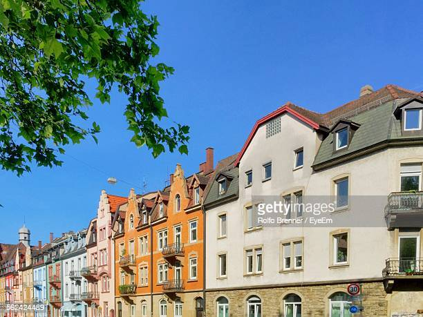 Townhouses In Row On Sunny Day