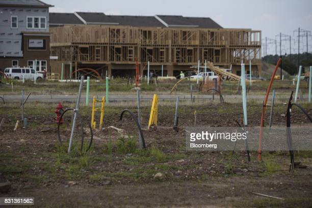 Townhouses stand under construction in North Brunswick New Jersey US on Thursday Aug 10 2017 Between US Route 1 and tracks for the Northeast Corridor...