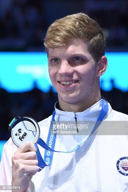 US Townley Haas celebrates on the podium after the men's 200m freestyle final during the swimming competition at the 2017 FINA World Championships in...