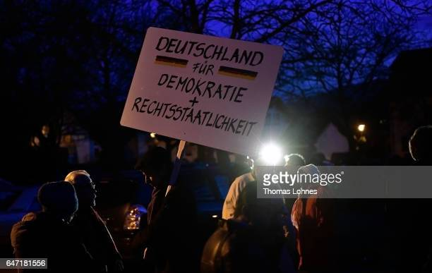 Townpeople demonstrate outside the Festhalle Bad Rotenfels hall for the freedom of the journalist Deniz Yuecel and democracy after a planned rally...