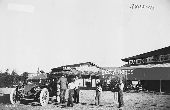 Townspeople of Ehrenburg Arizona Territory greet a stranger in an automobile on his pioneer crosscountry tour Saloon in background Ca 1911 | Location...