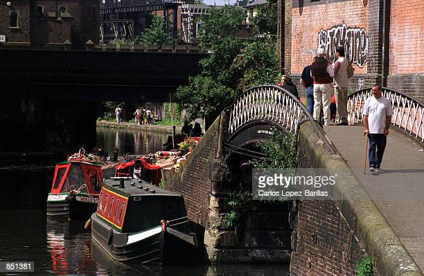 A towpath runs parallel to Regents Canal around the area of Camden Market July 30 2000 in Camden London The barges carrying goods on the canal were...