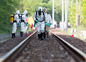 A team working with toxic acids and chemicals is approaching a chemical cargo train crash near Sofia, Bulgaria. Teams from Fire department are participating in an emergency training with spilled toxic