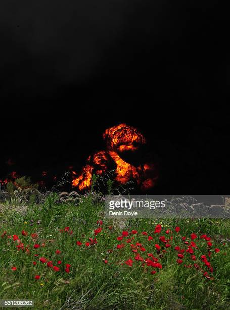 Toxic smoke rises over the Castilla La Mancha countryside after an illegal tyre dump went on fire on May 13 2016 in Sesena Nuevo Spain The dump which...