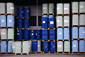The storage of toxic waste and chemicals in metal cans on the factory premises of a chemical plant.