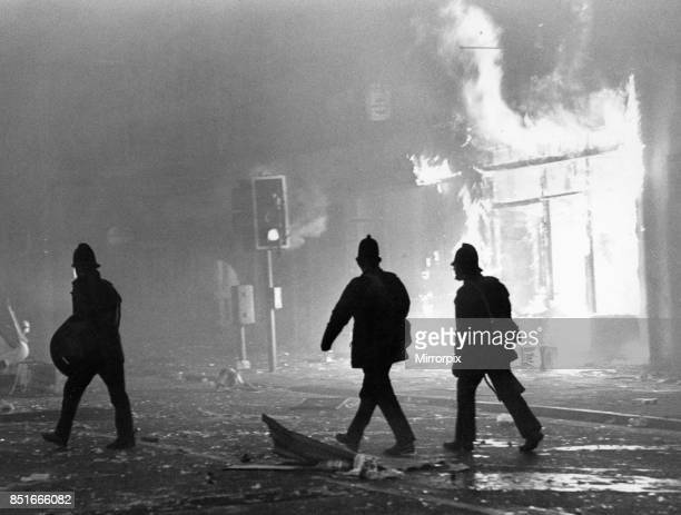 Toxteth Riot 6th July 1981 Police officers in riot gear outside a burning looted shop in Park Road The riots was sparked following the interception...