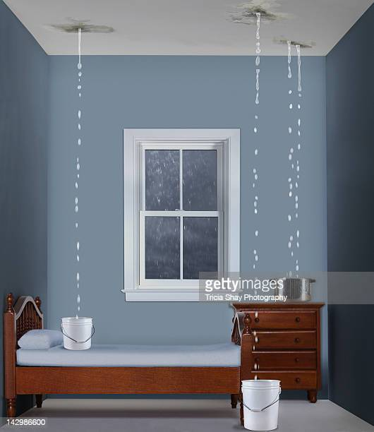 Toy bedroom with water dripping from ceiling