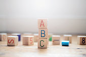 Toy building blocks stacked to spell out ABC