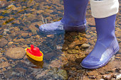 toy boat and kids wellies