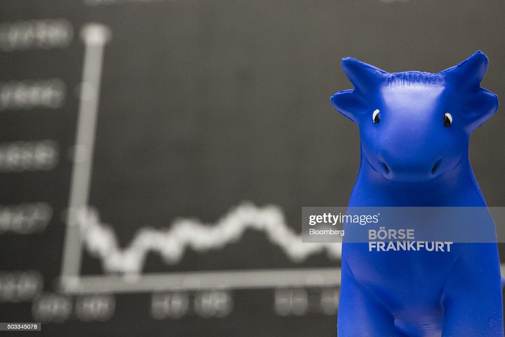 A toy bull sits in front of the DAX Index curve at the Frankfurt Stock Exchange in Frankfurt Germany on Monday Jan 4 2016 Financial markets are...