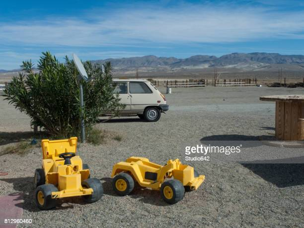 Toy Bulldozers in Parking Lot