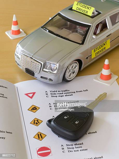Toy car, car key, and driver's license test