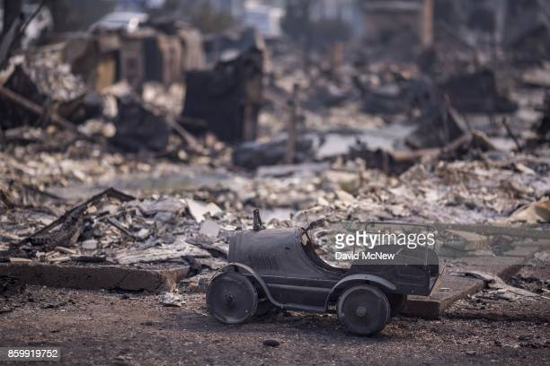 A toy car is left scorched in a neighborhood destroyed by fire near Cardinal Newman High School on October 10 2017 in Santa Rosa California In one of...