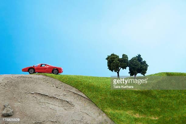 Toy car on model landscape