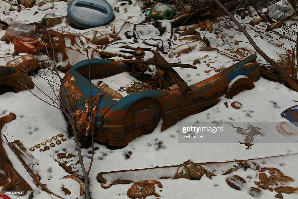 A toy car sits in the snow outside the abandoned Packard Automotive Plant December 13, 2013 in Detroit, Michigan. Peru-based developer Fernando Palazuelo made his final payment on the Packard Plant, which he won during a Wayne County auction for $405,000. Palazuelo plans on developing the former automotive plant where luxury Packard cars were made in the coming years.