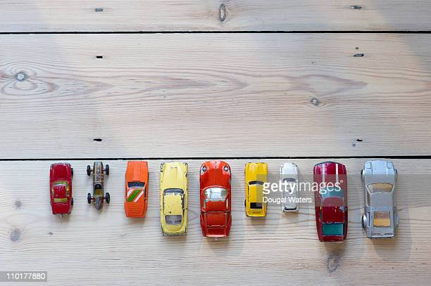 Toy cars lined up in a row on floor