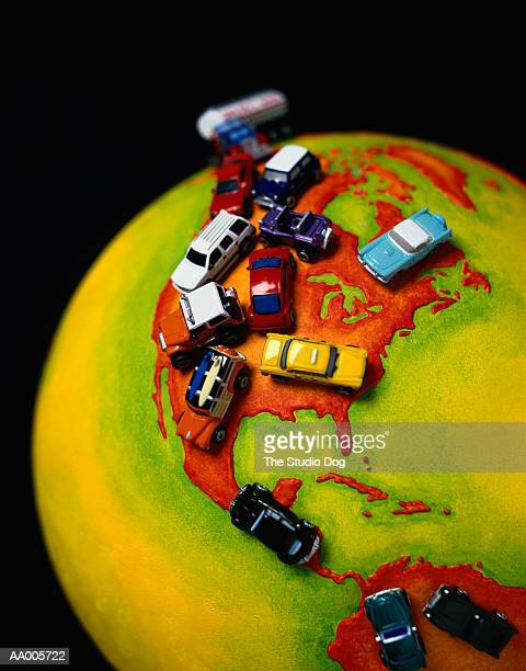 Toy Cars on a Globe Depicting the Americas
