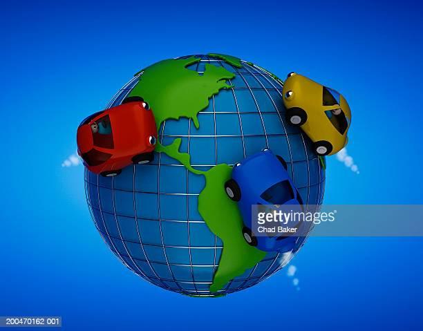 Toy cars on globe (Digital)