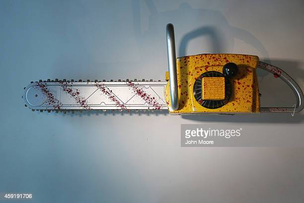 A toy chainsaw is displayed after being confiscated at an airport security checkpoint at the JFK International Airport on November 18 2014 in New...