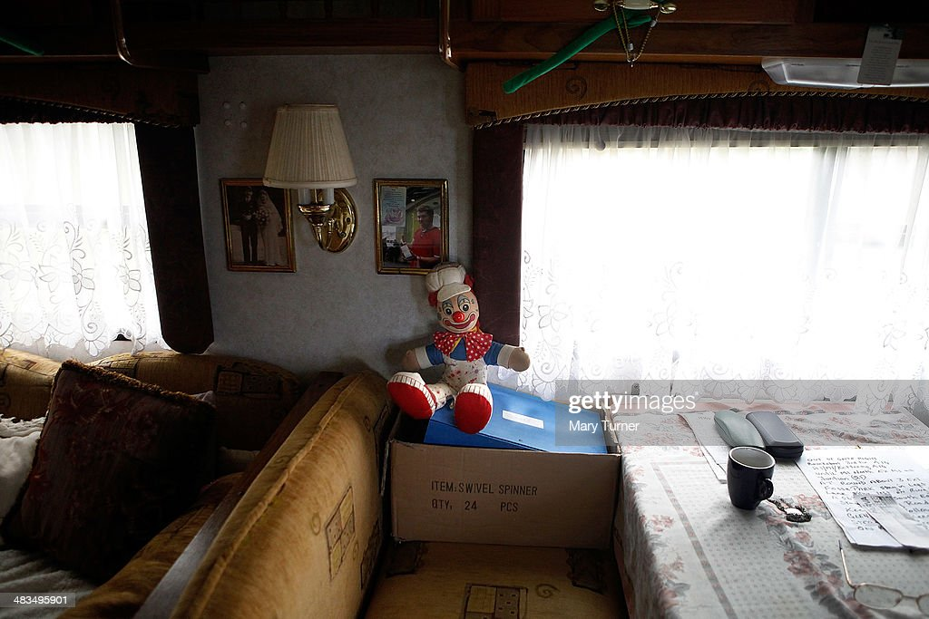 A toy clown sits in a trailer belonging to Karl Brenner, aged 75 and the oldest working professional clown, who performs with his son Jan Erik Brenner's company 'Mr Fips' Wonder Circus' , on April 7, 2014 in Huntingdon, England. Mr Fips Wonder Circus is a small, family run circus, who during their latest season will travel up the east of England until their season draws to a close in November. They are a company of around 20 performers, all family and friends from the circus community and their youngest member is 12 years old and their oldest is 75 years old. The troupe formed three years ago when Jan Erik Brenner and his wife Carolyn decided that they wanted to return the circus to the intimacy and magic of their childhood memories, and now play to audiences of between 100 and 500 adults and children.