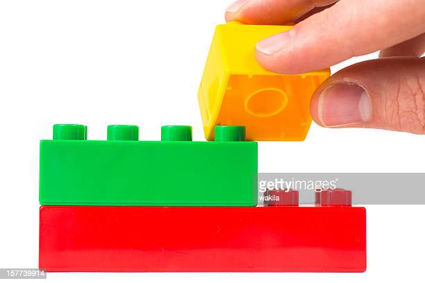 toy cubes with hand building