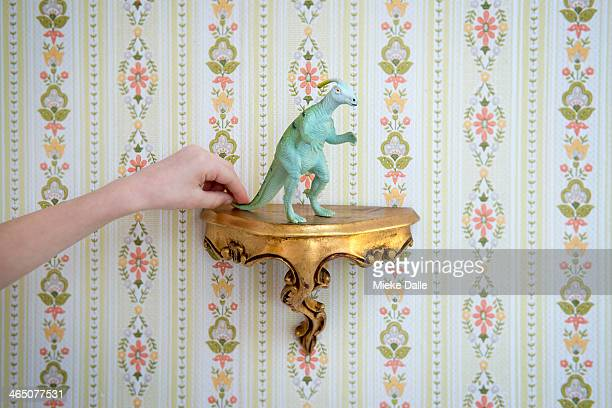 Toy dinosaur on a stand in a granny interior