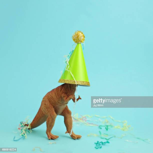 Toy dinosaur wearing a party hat