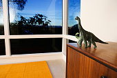 Toy dinosaurs on cabinet