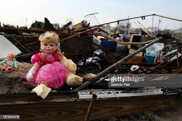 A toy doll is viewed on the remains of homes December 4 2012 in the Breezy Point neighborhood of the Queens borough of New York City Breezy Point...