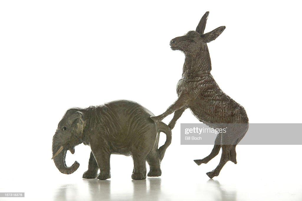 Toy donkey mounting a toy elephant : Stock Photo