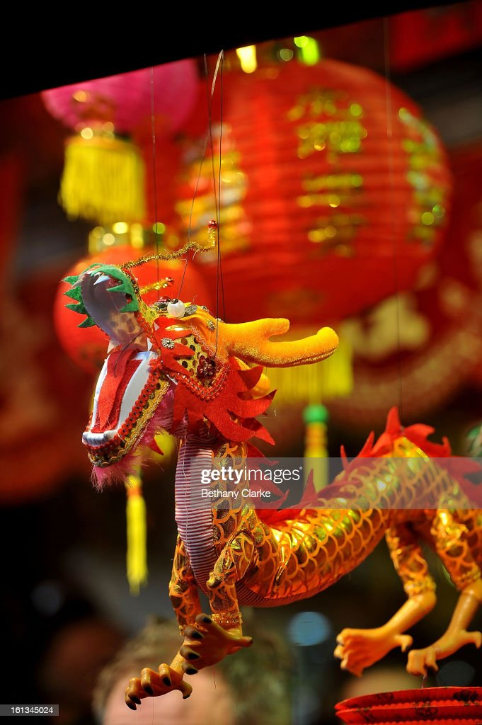Toy dragons hang in a toy stall in China Town February 10, 2013 in London, England. London's Chinese community celebrate the start of the Year of The Snake with traditional dancing, music and fireworks.