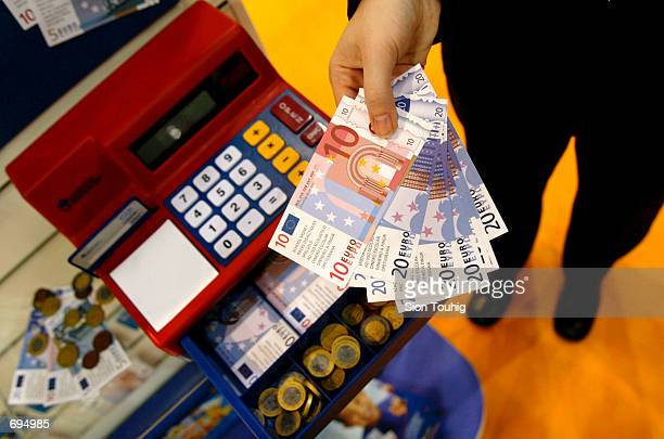 A toy exhibitor holds toy Euro currency notes intended for educational use for children in elementary schools January 28 2002 in London England The...