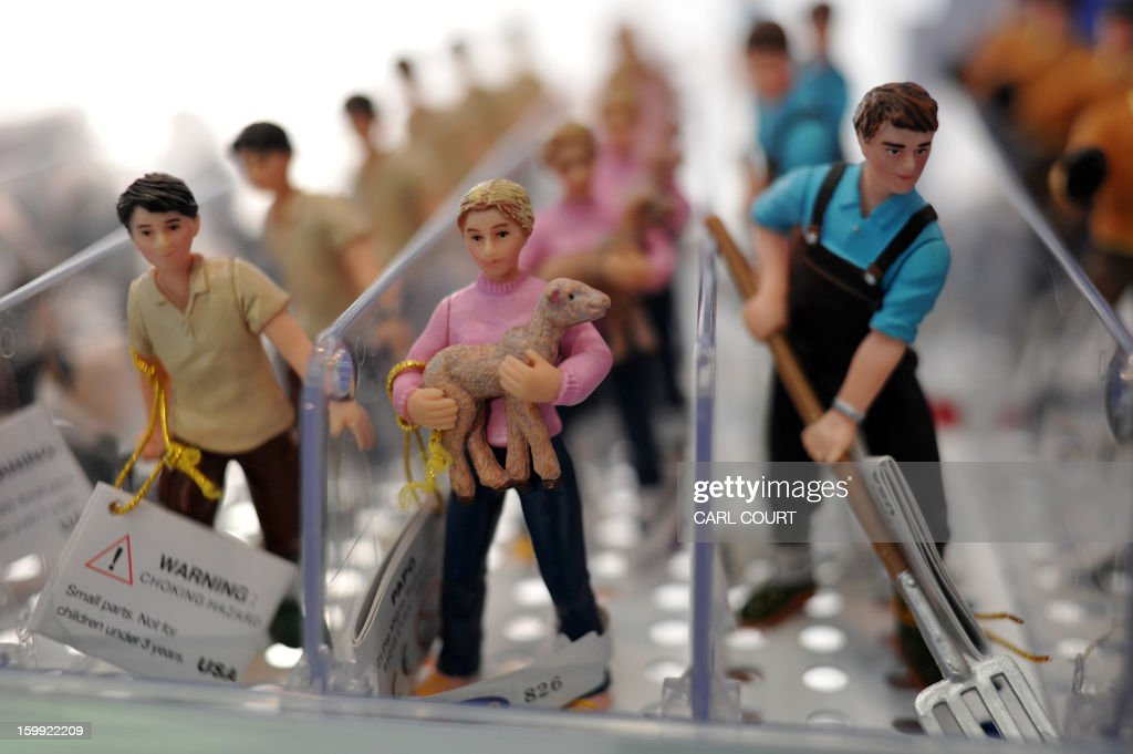 Toy farm workers are displayed at the London Toy Fair in Olympia, central London, on January 23, 2013.