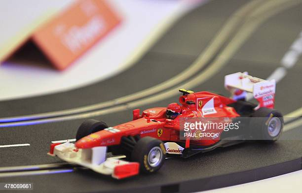 A toy Formula One race car pedalpowered by Ferrari driver Kimi Raikkonen of Finland races around the track during a promotional event ahead of the...