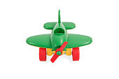 Children toy - a small green plane with a propeller without a pilot, isolated on a white background