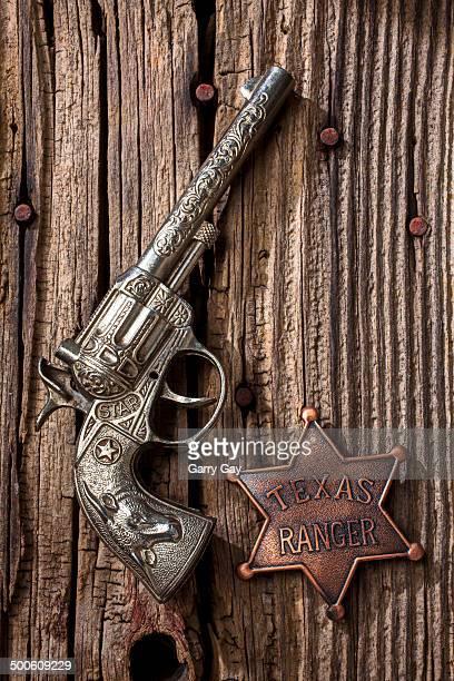 Toy gun and star ranger badge