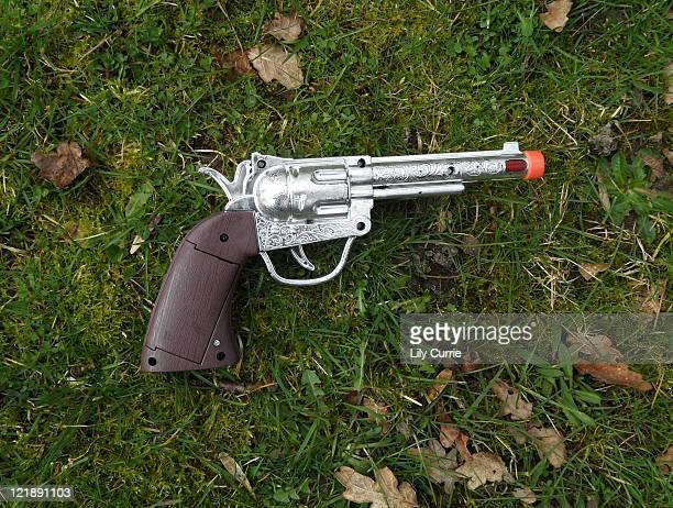 Toy gun in grass