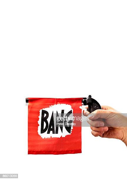 Toy gun with flag coming out barrel reading bang
