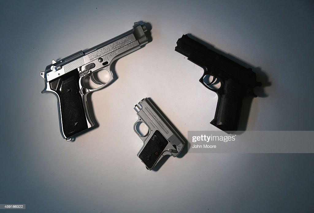 Toy guns are displayed after being confiscated at airport security checkpoints at the JFK International Airport on November 18 2014 in New York City...