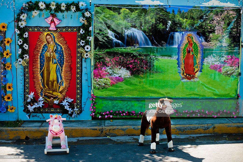 Toy horses are set for clients in a makeshift photo studio outside the Basilica de Guadalupe church in San Salvador El Salvador on December 12 2014...