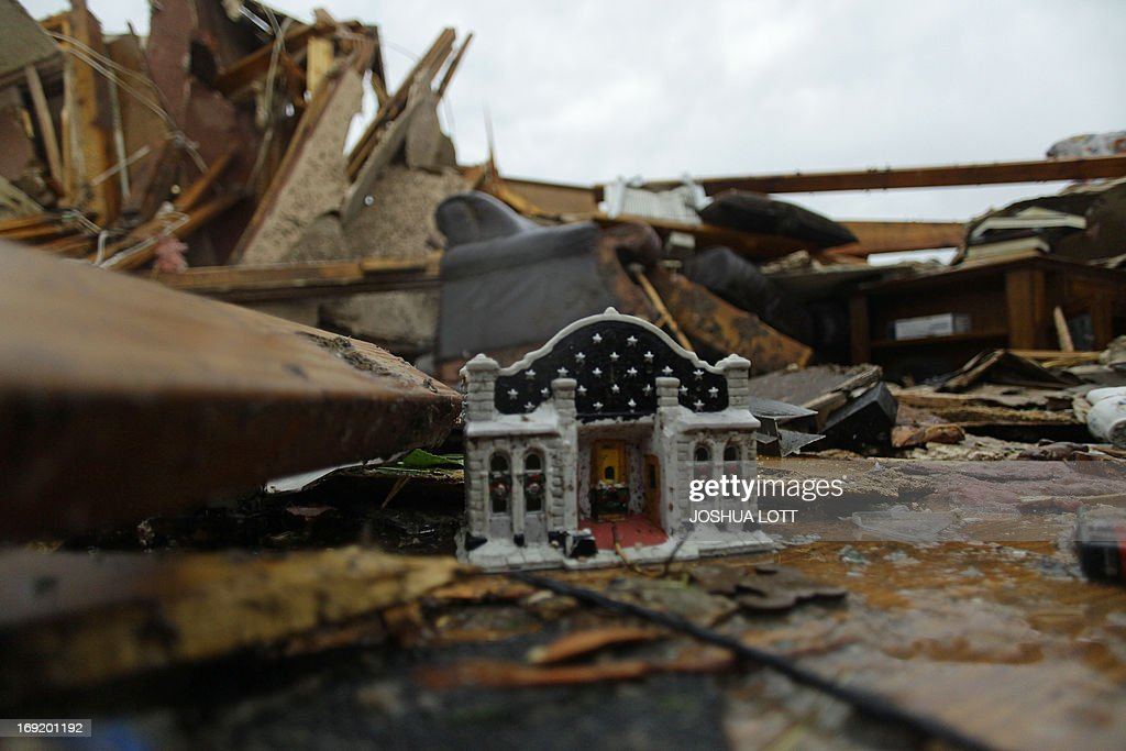 A toy house sits inside a destroyed home on May 21, 2013 in Moore, Oklahoma. Families returned to a blasted moonscape that had been an American suburb Tuesday after a monstrous tornado tore through the outskirts of Oklahoma City, killing at least 24 people. Nine children were among the dead and entire neighborhoods vanished, with often the foundations being the only thing left of what used to be houses and cars tossed like toys and heaped in big piles. AFP PHOTO/Joshua LOTT