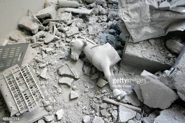 A toy lying on the wreckage of the house was hit by an Israeli military strike in Rafah in the southern Gaza Strip Palestinian factions have agreed...