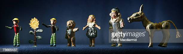 Toy models of popular 1950s childrens television characters Bill and Ben Teddy Looby Lou Andy Pandy and Muffin the Mule are displayed at Christie's...